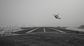 Helicopter landing. Black and white picture of a helicopter landing in Macao royalty free stock photography