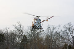 Helicopter landing in field Royalty Free Stock Image