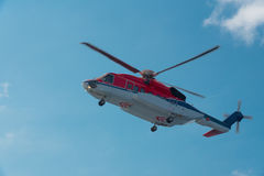 Helicopter is landing. Helicopter flying against the blue sky stock images