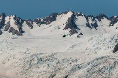 Helicopter landing on Franz Josef Glacier Royalty Free Stock Image