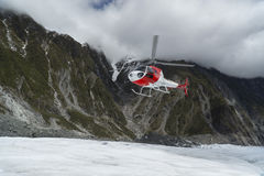 Helicopter landing on Franz Josef Glacier Stock Photos