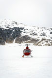 Helicopter landing on glacier Stock Image