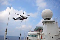 Chopper landing on helideck stock images