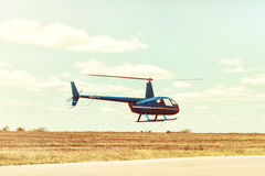 Helicopter landing at the helipad. All logos and text removed stock image