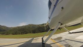 Helicopter landing on a helipad in a mountainous area. Small lightweight aviation. bottom view on a propeller blades