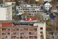 Helicopter landing on the hospital roof in Thun City Royalty Free Stock Photography