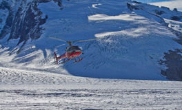 Helicopter landing on Mendenhall glacier. Mendenhall Glacier is a glacier about 13.6 miles long located in Mendenhall Valley, about 12 miles from downtown Juneau Royalty Free Stock Photo