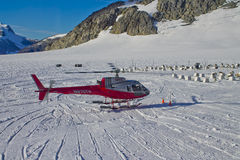 Helicopter landing in Mendenhall glacier. Mendenhall Glacier is a glacier about 13.6 miles long located in Mendenhall Valley, about 12 miles from downtown Juneau Royalty Free Stock Photo
