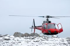 Helicopter landing on the mountain Stock Images