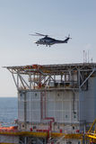 Helicopter landing on an offshore oil-plant Royalty Free Stock Photography