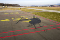 Helicopter landing shadow Royalty Free Stock Image