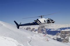 Helicopter landing in ski region Royalty Free Stock Photography
