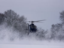 Helicopter landing in the snow Royalty Free Stock Photos