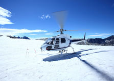 Helicopter stand on snow stock image