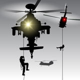 Helicopter with landing troops Royalty Free Stock Images