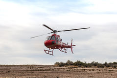 The helicopter lands in the desert Stock Photos