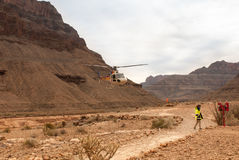The helicopter lands in the desert Royalty Free Stock Image