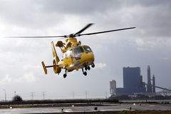Helicopter leaving the helipad in an industrial area Stock Photography
