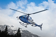 Helicopter leaving in mountain Stock Photography