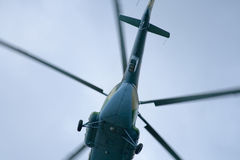 Helicopter in a low flight Stock Photo