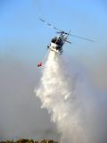 Helicopter Low Pass. Fire Attack helicopters dropping water on a bushfire. Perth, Western Australia stock photography