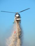 Helicopter Low Pass 2. Helicopter dropping water on a bushfire stock photography