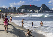 A helicopter lowers a rescued swimmer onto Copacabana Beach in Rio de Janeiro, Brazil. Royalty Free Stock Photos