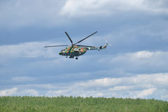 The helicopter makes a circle over the ground Stock Photo