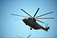 Helicopter in May 9th Victory Parade, Moscow, Russia. Military helicopter flying against blue skies in May 9th Victory Parade air show 2016 in Moscow, Russia Royalty Free Stock Images