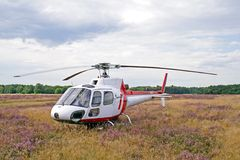 Helicopter on meadow Stock Photo