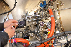 Helicopter Mechanic. Fine Tuning Engine Stock Photos