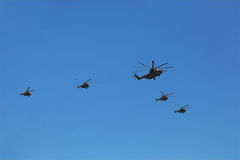Helicopter Mi-26 accompanied by group of Mi-8 Stock Photography