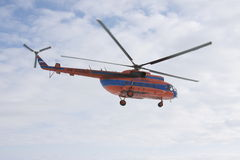 Helicopter Mi-8 in sky. Helicopter Mi-8 air companies Taymyr flying in sky royalty free stock photography