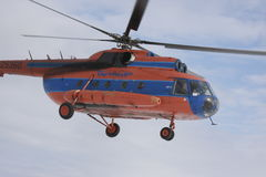 Helicopter Mi-8 in sky. Helicopter Mi-8 air companies Taymyr flying in sky stock photography