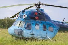 Helicopter MI-2. Blue helicopter MI-2 on the aerodrome Stock Photos