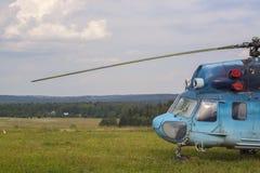 Helicopter MI-2. Blue helicopter MI 2 on the aerodrome Stock Photos