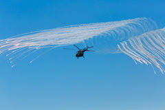 Helicopter Mi-8 launches anti-missiles Royalty Free Stock Photography