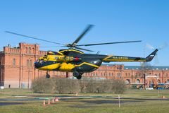 The helicopter Mi-8TV RA-24100 of Alliance Avia AON takes off against the background of the Museum of Artillery. ST. PETERSBURG, RUSSIA - APRIL 07, 2018: The Royalty Free Stock Images