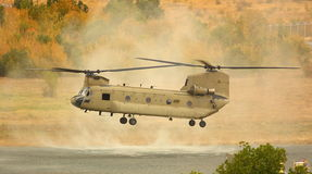 Helicopter. Military helicopter (Chinook) landing on a mountain background royalty free stock photo