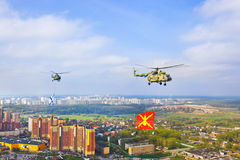 Helicopter with military flag over Moscow Stock Photography
