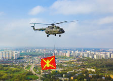 Helicopter with military flag over Moscow at parade of victory d Stock Photos