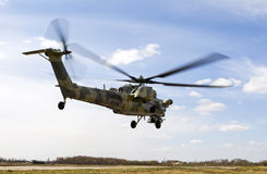 Helicopter. Military helicopter takes off from a field on a sunny day Royalty Free Stock Images