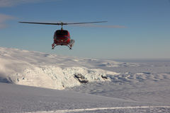 Helicopter at Mount Erebus, Antarctica Stock Images