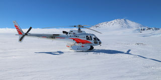 Helicopter at Mount Erebus in Antarctica Royalty Free Stock Images