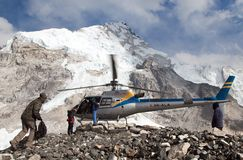 Helicopter in Mount Everest base camp. EVEREST BASE CAMP, NEPAL, 27th APRIL 2016 - helicopter in Mount Everest base camp and mount Nuptse, Nepal royalty free stock photos