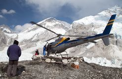 Helicopter in Mount Everest base camp. EVEREST BASE CAMP, NEPAL, 27th APRIL 2016 - helicopter in Mount Everest base camp and mount Nuptse, Nepal royalty free stock images