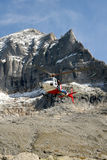 Helicopter in mountain Stock Photo