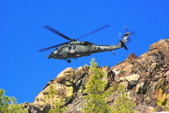Helicopter Mountain Air Rescue. Air rescue by helicopter in the mountains at high altitude Royalty Free Stock Photography