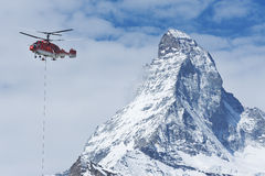 Helicopter and mountain Royalty Free Stock Photo