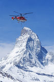 Helicopter and mountain Stock Photo